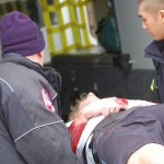 EMT workers transports Evan Hoppman onto the ambulence