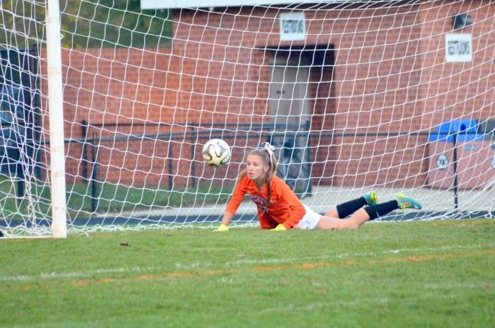 Junior Hannah Sarsony dives to prevent the ball from reaching the goal