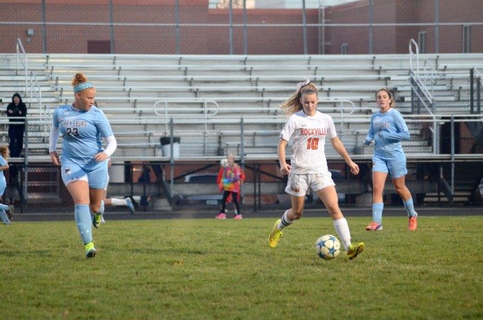 Junior Allison DiFonzo dribbles the ball away from the Clarksburg players.