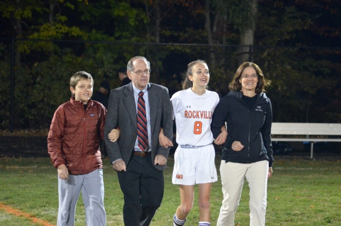 Weiler walks the field with her family during the senior night event between the girls and boys games.