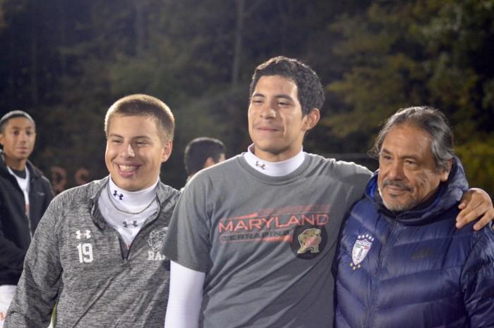 (Left to Right) Junior Thomas Da Silva, Senior Alejandro Beatres, and Coach Julio Zarate pose for a picture.