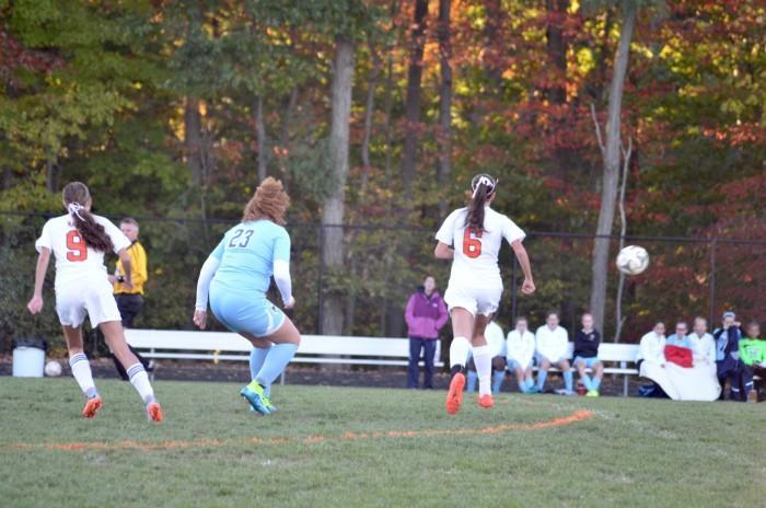 Junior Danielle Dean and Giron runs around the field.