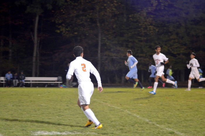 Senior Ronaldo Reyes runs towards the direction the ball is heading,