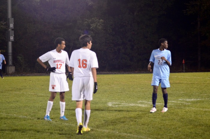 Seniors Emmanuel Benyam and Kevin Pereira watch the action of the game.