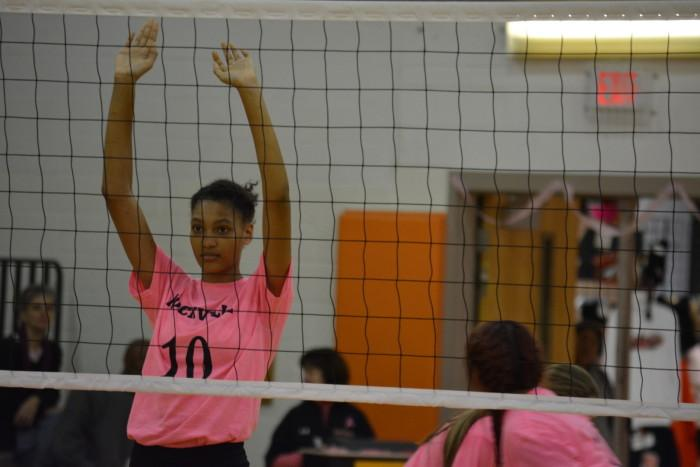 Junior Jaylah James stands at the net to defend against Walter Johnson.