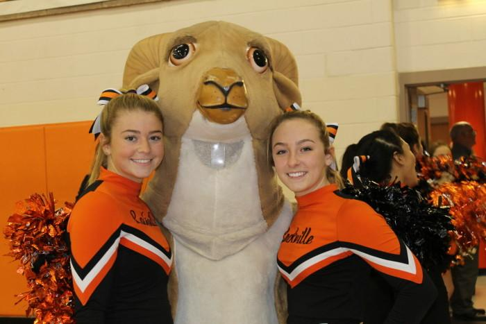 Seniors Skye Nielsen and Erin Moriarty pose with Rammy before the pep rally.