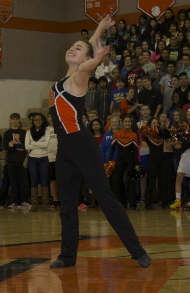 Mia Krawczel performs a baton routine.