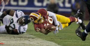 Washington Redskins quarterback Robert Griffin III dives for a first down in the first half against Seattle Seahawks during the first round of the NFC wild-card playoff game at FedEx Field in Landover, Maryland, Sunday, January 6, 2013. Courtesy of MCT Campus