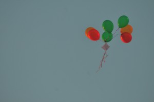 A boquet of balloons holding a note flies through the air. Several students wrote notes on the balloons as well as writing a paper note. --Sarah Huang, Yearbook