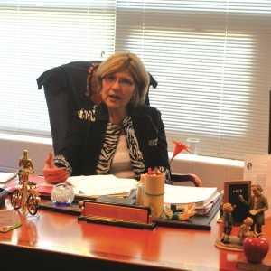 Munk sitting at her desk during the school day. Adam Bensimhon