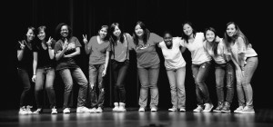 Members of the Asian American Club pose onstage after a performance at International Night May 3. This night is an annual event at RHS where students can celebrate their heritage, bring in traditional foods and perform. --Courtesy of Stephan Han