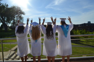 Heavenly Williams, Torey Vayer, Adrienne Tantardini and Tess Garraty look off into the distance while holding up a one and three to represent the year they are graduating. --Camila Torres