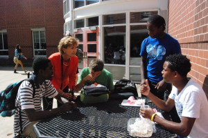 New Principal Billie-Jean Bensen talks with students outside the school building during lunch. Bensen has been working to become more familiar with the many faces of RHS. --Mercy Fosah