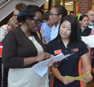 Sophomore ambassador Katrina Le helps parents find their assigned classrooms according to their childrens' schedule during Back to School Night on Aug. 29. --Adam Bensimhon