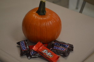 A teacher's desk is showing of the Halloween spirit, affixed with pumpkins and candy. --Elissa Britt