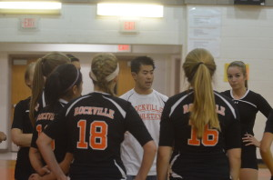 Varsity volleyball coach Sean Pang motivates the team during a match against Gaithersburg High school Sept. 24. The Lady Rams look to catch their stride in their upcoming matches and gain momentum going into their final stretch of the season. --Adam Bensimhon