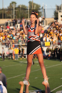 Sophomore Dani Sobel excites the crowd as she is lifted in the air at the Richard Montgomery football game during an exciting Rams win. --Kaylee Davis