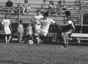 Junior Anibal Saenz Jr. kicks the ball past an opposing player during the Rams 2-0 victory over the Seneca Valley Screaming Eagles on Sept. 26. The Rams earned their first victory in two seasons in a impressive defensive and offensive showing. --Adam Bensimhon