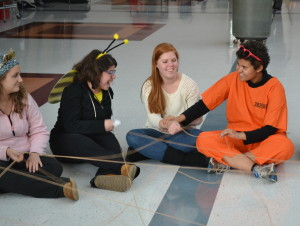 From left: Ellie Hambrecht, Jessica Hetchkop, Haley Oa��Brien and Julie Ramos play a web game during the Match party Oct. 28. Buddies were paired through a personality survey.