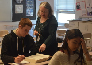 College test prep teacher Anne Ehlers assists senior Doug Trach with SAT practice questions. The course helps prepare students for all sections of the SAT: critical reading, math and writing. --Adam Bensimhon