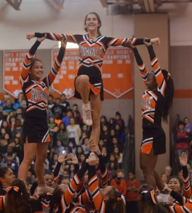 Varsity cheerleaders freshmen Gabrielle Kessel and Marie Noel Gomis lift sophomore Kelsey Hylton during their pep rally routine. They are eager to begin cheering at basketball games. --Adam Bensimhon