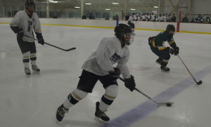 Freshman defenseman Koby Kovacs pushes the puck up the ice in the team's season opening 10-0 victory over Damascus HS Nov. 15. Kovacs is a young player who looks to lead the team in the future. --Adam Bensimhon