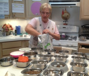 Sher Polvinale fixes dinner for the House With A Heart residents.  She begins to fix dinner in the early afternoon because many of the dogs have special dietary needs that require different types of food. --Katie Aceto