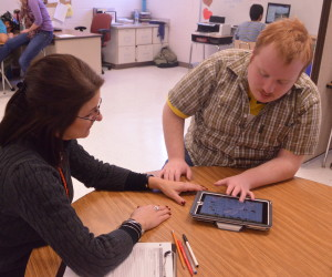 Autism teacher Laura Trumble uses an app on the iPad when working with a student. Trumble and her students use apps such as AutisMate to improve skills. --Adam Bensimhon