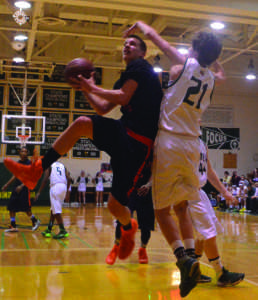 Senior guard Brian Ball drives to the basket against a Damascus defender Feb 20. Ball, a captain of the team, had 11 points and six rebounds. --Adam Bensimhon