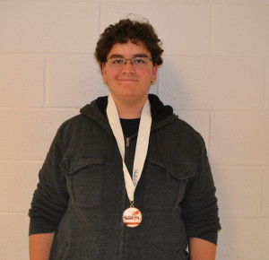 Junior Loren Hersh poses with his first place medal in computer maintainance. --Claudia Mirembe