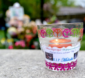 A memorial candle is placed near the gravesite of former senior Michelle Miller, who was killed in a murder-suicide last April. Miller's friends and classmates came together to remember her April 8. --Camila Torres
