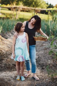 Counselor and cookbook author Wendy Kiang-Spray shown in her garden with daughter Lyric. Photo Courtesy of Sarah Culver