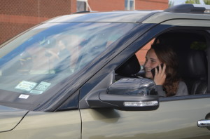 Senior Kathleen McTighe mimics a phone call while driving. --Elissa Britt