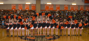 The poms perform their signature move, the worm, at the first pep rally of the year Sept. 5. --Claudia Mirembe