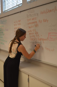 Senior Lauren Goldstein helps organize future school functions by writing the events that need to be planned. --Mercy Fosah