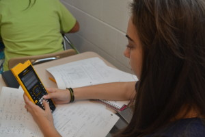 Senior Michaela Berger uses the new TI-Nspire in her AP Calculus BC class. The calculators are available in most math classes, and offer many new features. --Elissa Britt