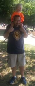 Nick Shuler holds his son Oden at the Buddy Walk. Photo Courtesy of Rene Shuler