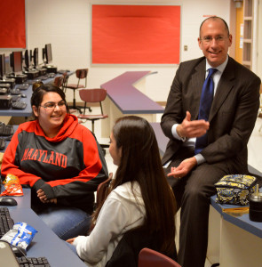Senior ACES students Deanna Dubbaneh (left) and Camila Madeo (right) work with Superintendent Dr. Joshua Starr during his visit to RHS Nov. 13. --Meklit Bekele