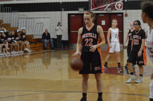 Senior captain Kathleen McTighe prepares for a free throw against Quince Orchard HS. The Lady Rams lost 45-39, making only nine of 20 free throws. Weaver now emphasizes practicing free throws because it will help win games. --Claudia Mirembe