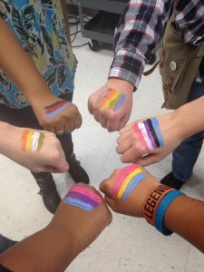 Students showing solidarity and recognition of their ignored sexual, romantic, and gender identities, by painting their respective flags on their hands. --Melanie Atzili