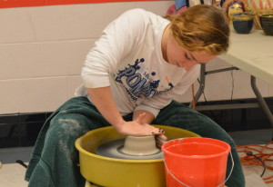 After centering her clay, junior Erin Moriarty crafts her bowl on the potter's wheel during Art Blitz Week. The event ran from Jan. 26 to Jan. 30 in the arts hallway to help recruit students for art classes. --Elissa Britt