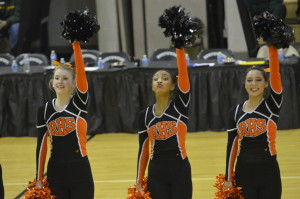 Senior captain Madison Cary (left) along with juniors Ambre Flowers (middle) and Cristina Granados (right) perform during the county invitational at Northwest HS Jan. 21. The poms placed sixth, but are practicing a new routine to perform at county competitions. --Meklit Bekele