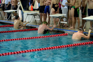 Junior Griffin Alaniz left and senior Konrad Swartz right prepare to race in the 100-yard backstroke against Kennedy HS Jan. 23. --Elissa Britt