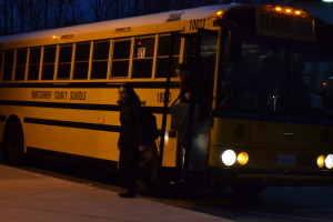 Sophomores Joanna Vigil (left) and Tristan Burch (right) get off of the school bus and head in while it is still dark out. Students have trouble maintaining a healthy amount of sleep every night. --Meklit Bekele