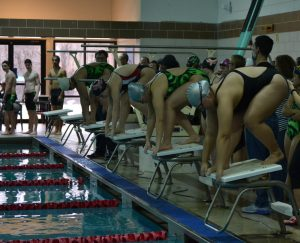 RHS and Kennedy HS swimmers take their mark as they prepare to race. The girls swim team has been facing challenges with participation this season, but still push through. --Elissa Britt