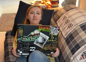 Senior Anna Walker opts to watch a movie on her laptop instead of paying the price at a movie theater.  --Thomas Sheil