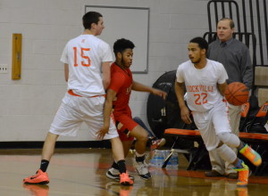Senior Kellen Cremins sets a pick for senior Rakeem Hoy-Farria as he dribbles for a layup. --Meklit Bekele