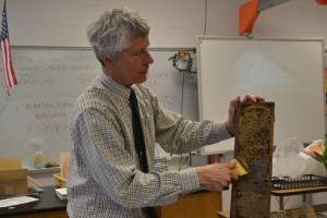 Gregg Gochnour shows his horticulture class a beehive. Students later extracted honey from the beehives with Gochnour's assistance and were allowed to eat it. --Camila Torres