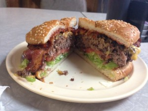 Sunshine's famous bacon cheeseburger moments after coming off the grill. Make sure to check out Sunshine for a great burger, you won't be disappointed! --Alexander Nagy