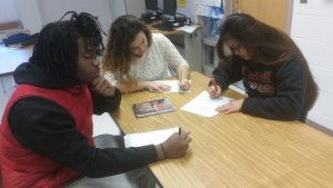 Juniors Dwayne Henry, Liliana Goncalves and Grace Cajayon practice writing college essays, one of the ways that Avid prepares its students for the college application process. --Ronaldo Reyes